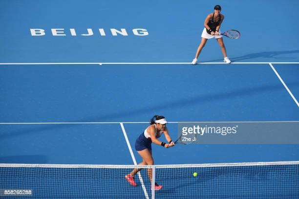 YungJan Chan of Chinese Taipei and Martina Hingis of Switzerland return a shot against Gabriela Dabrowski of Cananda and Yifan Xu of China during...