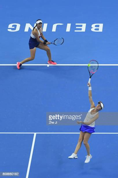 YungJan Chan of Chinese Taipei and Martina Hingis of Switzerland return a shot against Timea Babos of Hungary and Andrea Hlavackova of the Czech...