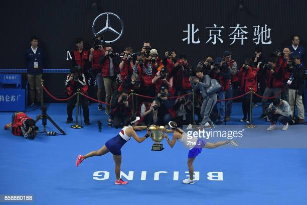 YungJan Chan of Chinese Taipei and Martina Hingis of Switzerland hold the winners trophy after winning the Women's Doubles Final against Timea Babos...