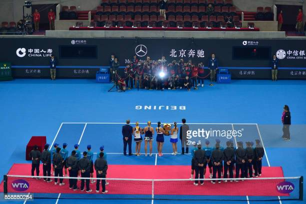 YungJan Chan of Chinese Taipei and Martina Hingis of Switzerland hold the winners trophy with Timea Babos of Hungary and Andrea Hlavackova of Czech...
