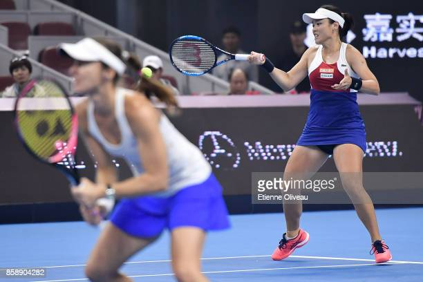 YungJan Chan of Chinese Taipei and Martina Hingis of Switzerland in action during their Women's doubles final match against Timea Babos of Hungary...