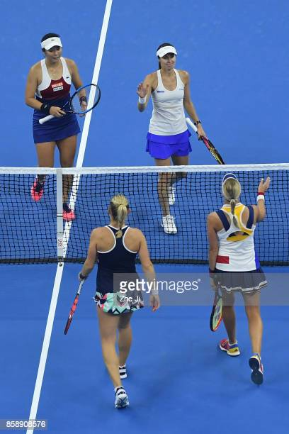 YungJan Chan of Chinese Taipei and Martina Hingis of Switzerland is congratulated by Timea Babos of Hungary and Andrea Hlavackova of Czech Republic...
