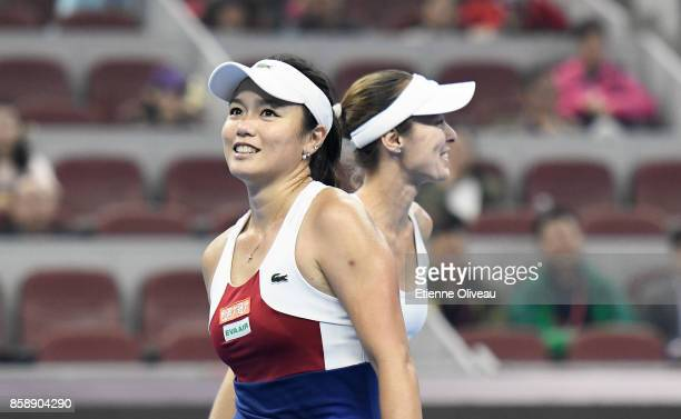 YungJan Chan of Chinese Taipei and Martina Hingis of Switzerland look on during their Women's doubles final match against Timea Babos of Hungary and...