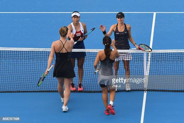 YungJan Chan of Chinese Taipei and Martina Hingis of Switzerland shake hands with Gabriela Dabrowski of Canada and Yifan Xu of China after winning...