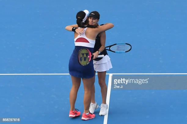 YungJan Chan of Chinese Taipei and Martina Hingis of Switzerland celebrate after winning the Women's Doubles Quarterfinals match against Gabriela...