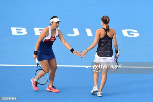 YungJan Chan of Chinese Taipei and Martina Hingis of Switzerland react during their Women's Doubles Quarterfinals match against Gabriela Dabrowski of...