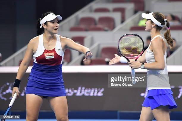 YungJan Chan of Chinese Taipei and Martina Hingis of Switzerland check hands during their Women's doubles final match against Timea Babos of Hungary...