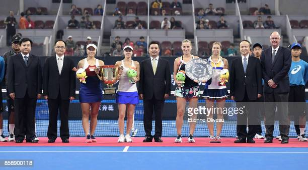 YungJan Chan of Chinese Taipei and Martina Hingis of Switzerland pose for a picture with officials as their hold the winners trophy and Timea Babos...
