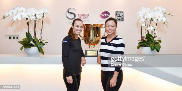 YungJan Chan of Chinese Taipei and Martina Hingis of Switzerland pose for a picture holding the winners trophy after winning the Women's Doubles...