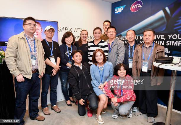 YungJan Chan of Chinese Taipei and Martina Hingis of Switzerland pose for a picture with fans after winning the Women's Doubles Final against Timea...