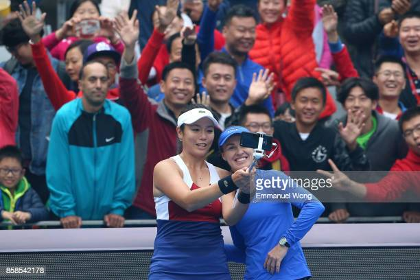 YungJan Chan of Chinese Taipei and Martina Hingis of Switzerland take a selfie after winning their Women's double semi finals match against Sania...