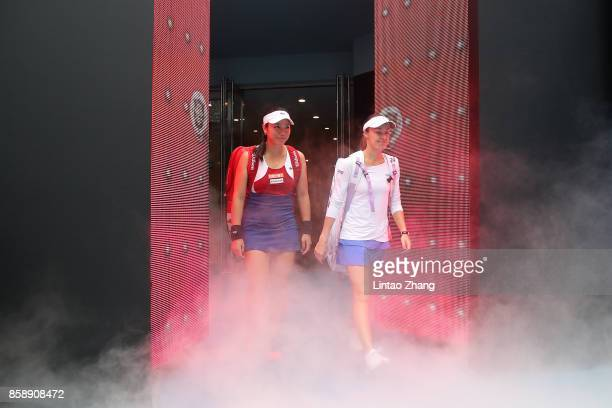 YungJan Chan of Chinese Taipei and Martina Hingis of Switzerland enters the tennis court during the Women's doubles final against Timea Babos of...