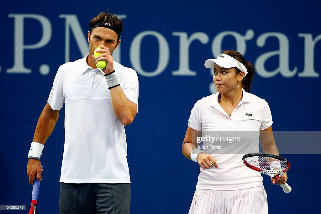 YungJan Chan of Chinese Taipei and Ross Hutchins of Great Britain speak during their mixed doubles second round match against Melanie Oudin of the...