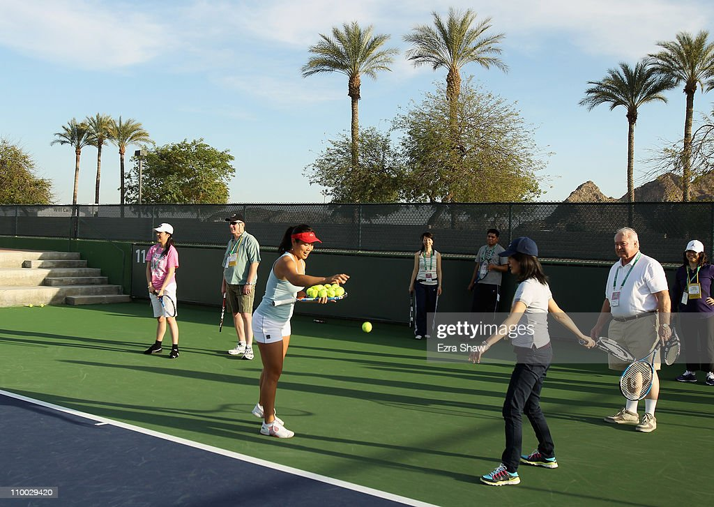 YungJan Chan of Chinese Taipei gives tennis advice at a USANA tennis clinic during the BNP Paribas Open at the Indian Wells Tennis Garden on March 12...