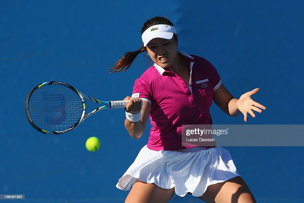 Yung-Jan Chan of Chinese Taipei plays a forehand in her first round match against Daniela Hantuchova of Slovakia during day one of the 2013 Australian Open at Melbourne Park on January 14, 2013 in Melbourne, Australia.