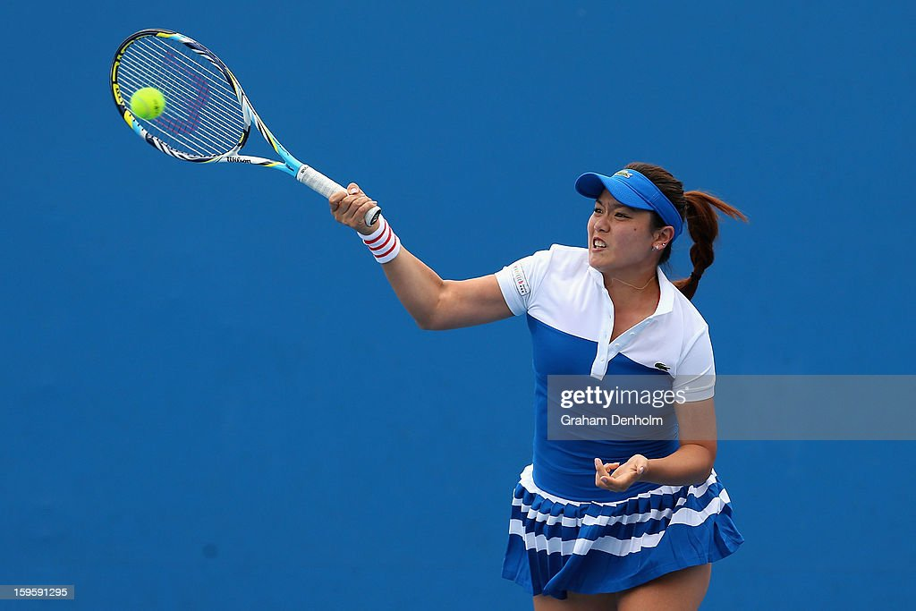 YungJan Chan of Chinese Taipei plays a forehand in their first round doubles match with HaoChing Chan of Chinese Taipei against Nuria Llagostera...