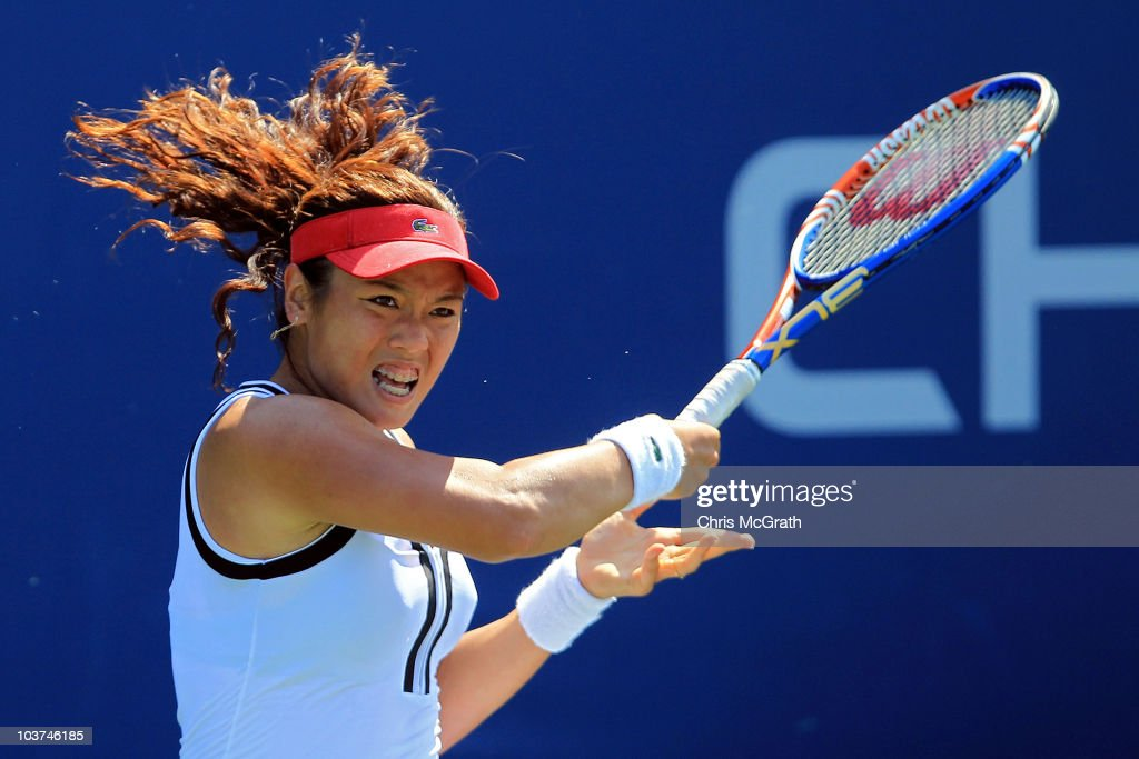YungJan Chan of Chinese Taipei returns a shot against Anne Keothavong of Great Britain during her women's singles first round match on day two of the...