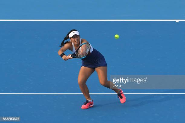 YungJan Chan of Chinese Taipei returns a shot against Gabriela Dabrowski of Canada and Yifan Xu of China during their Women's Doubles Quarterfinals...