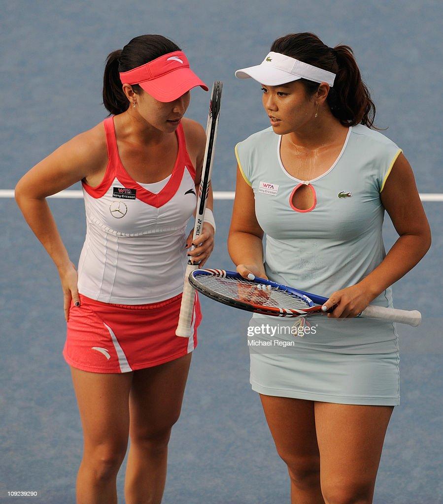YungJan Chan of Chinese Taipei talks to partner Jie Zheng of China during their doubles match against Vera Zvonareva of Russia and Svetlana...