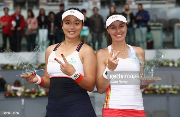 YungJan Chan of Taipei and Martina Hingis of Switzerland celebrate with the winners trophies after defeating Timea Babos of Hungary and Andrea...