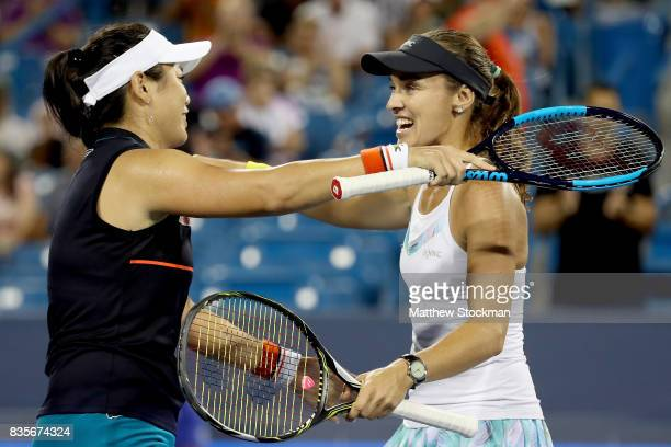 YungJan Chan of Taipei and Martina Hingis of Switzerland celebrate match point against SuWei Hsieh of Taipei and Monica Niculescu of Romania in the...