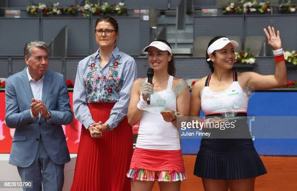 YungJan Chan of Taipei and Martina Hingis of Switzerland with the winners trophies after defeating Timea Babos of Hungary and Andrea Hlavackova of...
