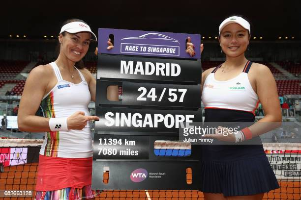 YungJan Chan of Taipei and Martina Hingis of Switzerland with the road to Singapore board after defeating Timea Babos of Hungary and Andrea...