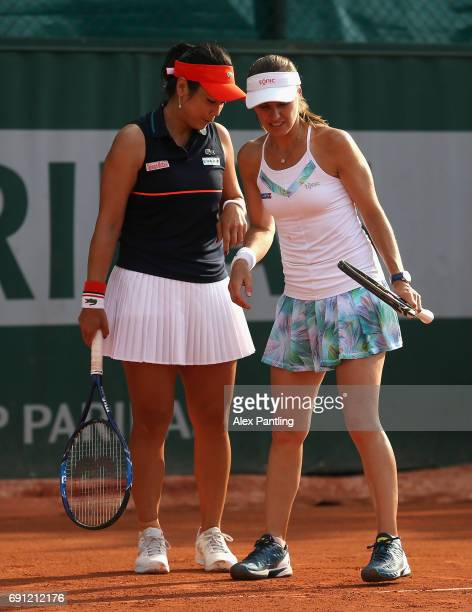 YungJan Chan of Taipei and partner Martina Hingis of Switzerland speak during the ladies doubles first round match against Naomi Broady of Great...