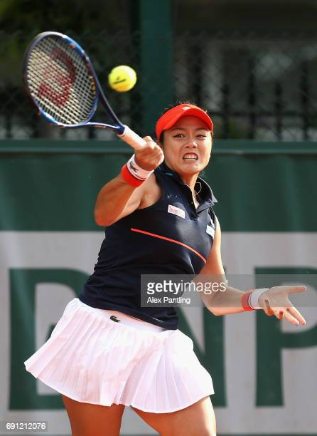 YungJan Chan of Taipei partner of Martina Hingis of Switzerland plays a forehand during the ladies doubles first round match against Naomi Broady of...