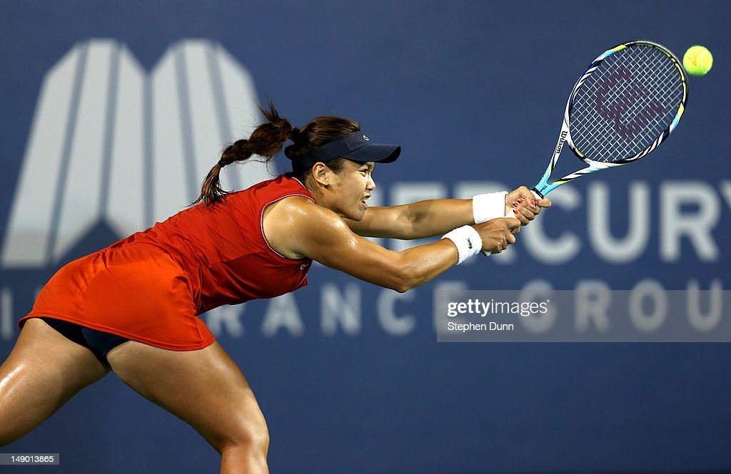 YungJan Chan of Taipei returns a serve against Marion Bartoli of France in their semifinal match during day eight of the Mercury Insurance Open...
