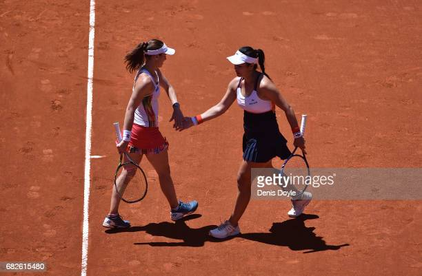 YungJan Chan of Teipei celebrates winning a point with doubles partner Martina Hingis of Switzerland during their women's doubles final match against...