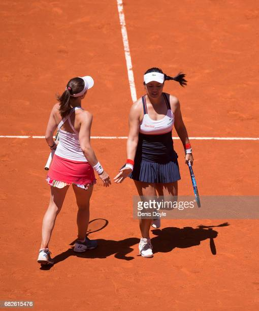YungJan Chan of Teipei celebrates winning a point with partner Martina Hingis of Switzerland during their women's doubles final match against Tomea...