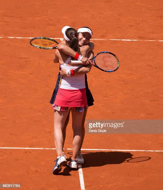 YungJan Chan of Teipei celebrates with doubles partner Martina Hingis of Switzerland after beating Tomea Babos of Hungary and Andrea Hlavackova of...