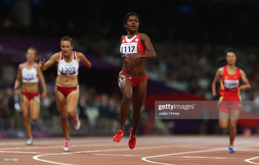 Yunidis Castillo of Cuba crosses the line to win gold ahead of Alicja Fiodorow of Poland (1302) in the Women's 200m - T46 Final on day 3 of the London 2012 Paralympic Games at Olympic Stadium on September 1, 2012 in London, England.