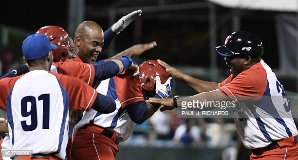 Yunielki Lourdes Gurriel of Cuba and teammates celebrate their 10th inning 32 victory over Puerto Rico in the San Juan Serie Del Caribe on February 4...