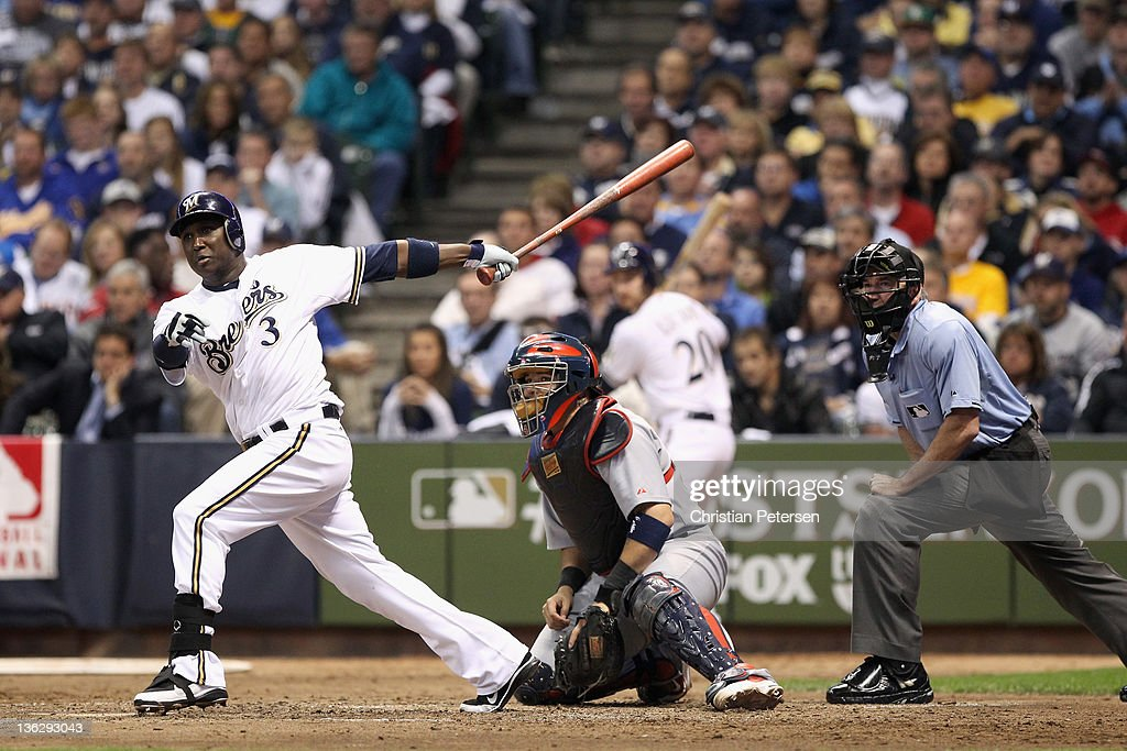 Yuniesky Betancourt of the Milwaukee Brewers bats against the St Louis Cardinals during Game Six of the National League Championship Series at Miller...