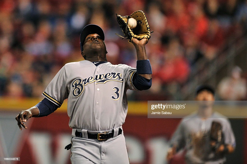 Yuniesky Betancourt of the Milwaukee Brewers catches a foul pop up hit by Todd Frazier of the Cincinnati Reds in the fifth inning at Great American...
