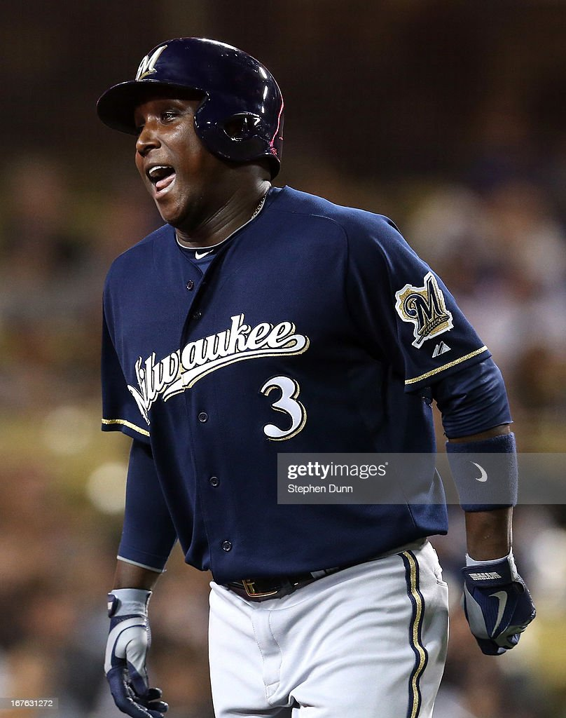 Yuniesky Betancourt of the Milwaukee Brewers celebrates as he returns to the dugout after hitting a solo home run in the fifth inning against the Los...