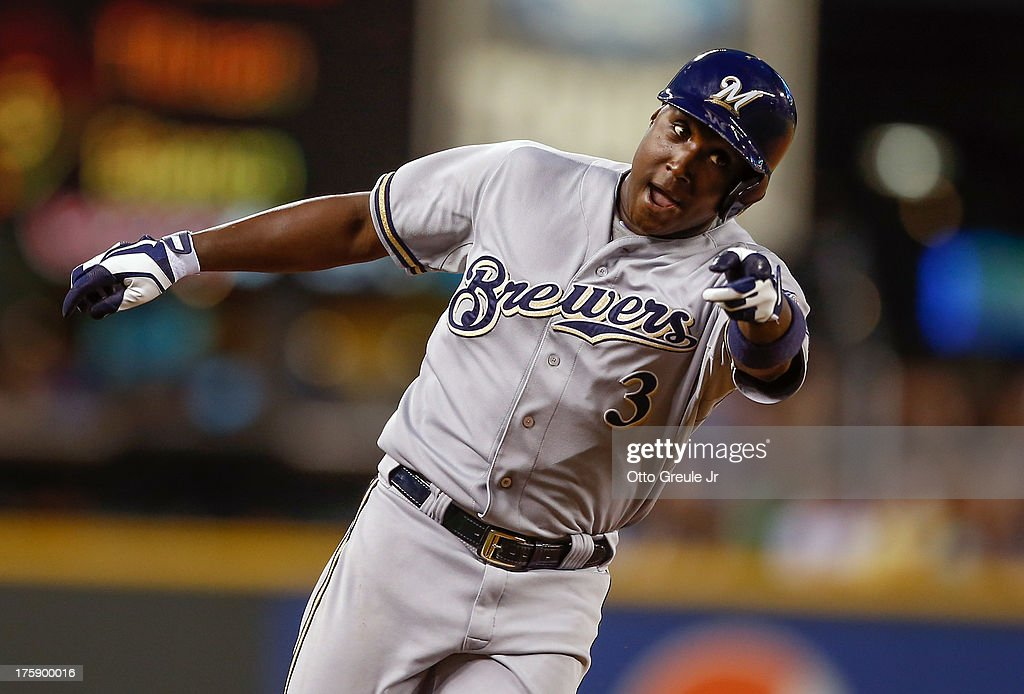 Yuniesky Betancourt of the Milwaukee Brewers gestures as he rounds the bases after hitting a grand slam in the fifth inning against the Seattle...