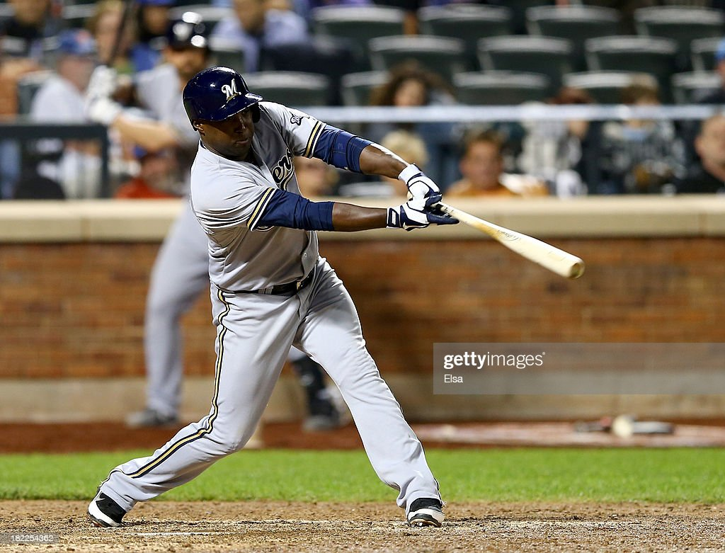 Yuniesky Betancourt of the Milwaukee Brewers gets a hit in the 10th inning against the New York Mets on September 28 2013 at Citi Field in the...