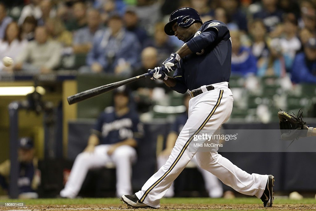 Yuniesky Betancourt of the Milwaukee Brewers hits a double scoring Caleb Gindl in the bottom of the sixth inning against the Chicago Cubs at Miller...
