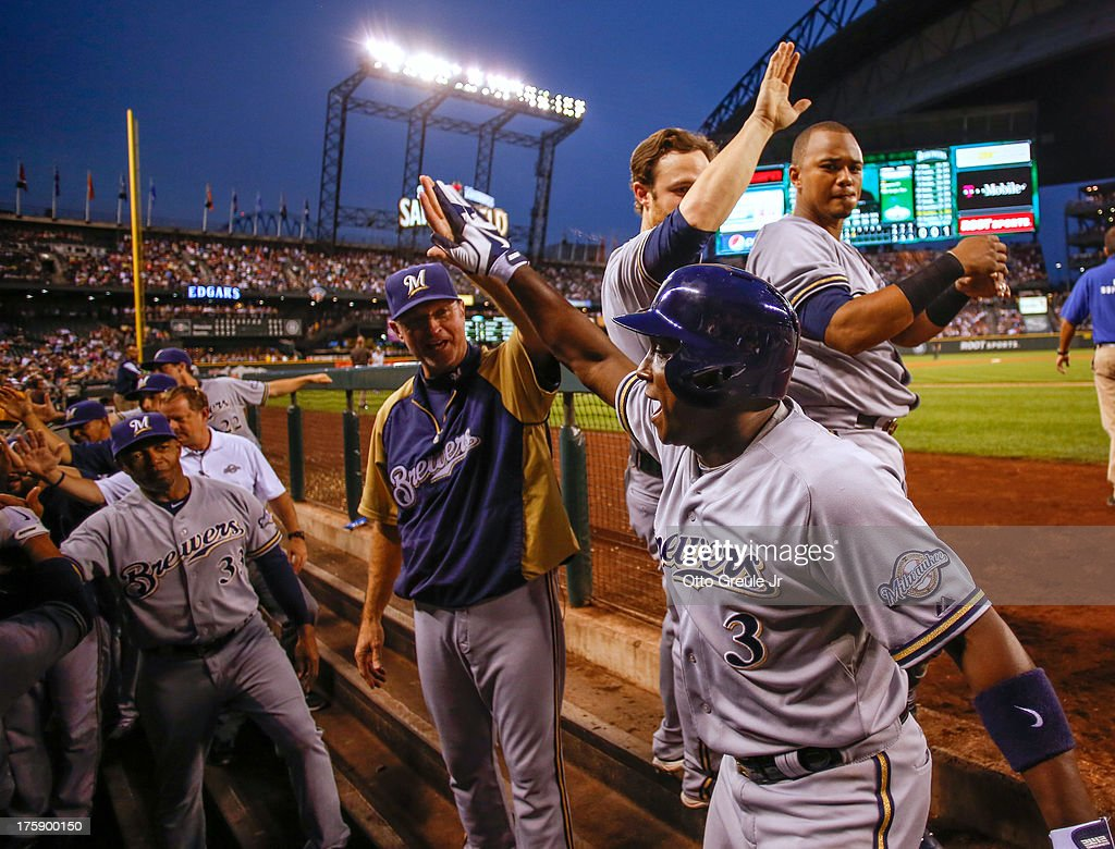 Yuniesky Betancourt of the Milwaukee Brewers is congratulated by teammates after hitting a grand slam in the fifth inning against the Seattle...