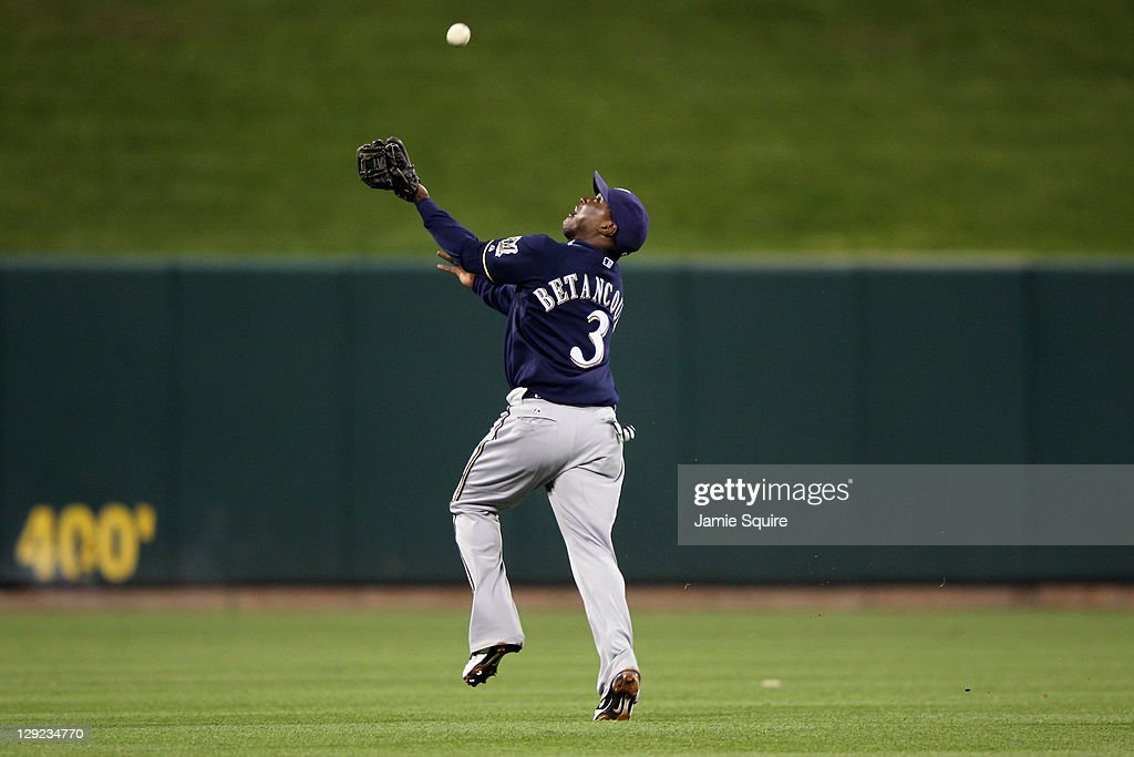 Yuniesky Betancourt of the Milwaukee Brewers makes a catch for an out on a ball hit by Jon Jay of the St Louis Cardinals in the bottom of the third...