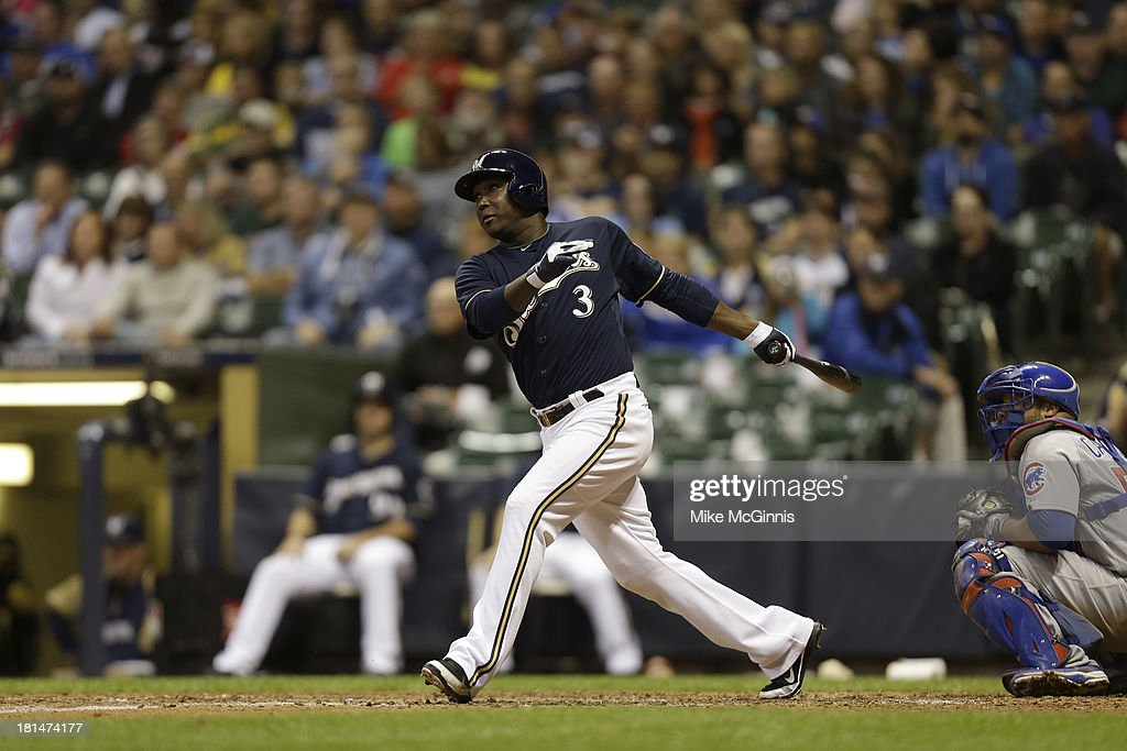 Yuniesky Betancourt of the Milwaukee Brewers makes some contact at the plate during the game against the Chicago Cubs at Miller Park on September 16...