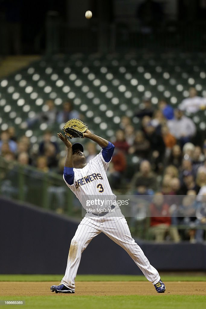 Yuniesky Betancourt of the Milwaukee Brewers makes the catch in the infield during the game against the Arizona Diamondbacks at Miller Park on April...
