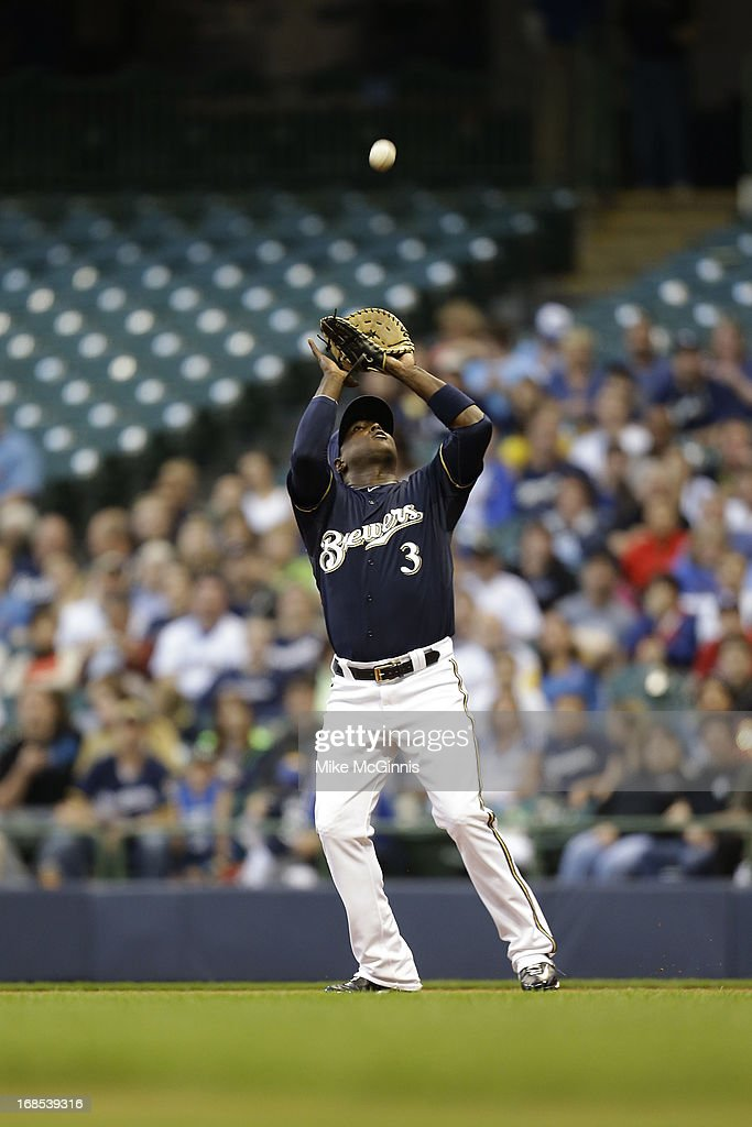 Yuniesky Betancourt #3 of the Milwaukee Brewers makes the catch in the infield for an out against the Texas Ranger during the game at Miller Park on May 07, 2013 in Milwaukee, Wisconsin.