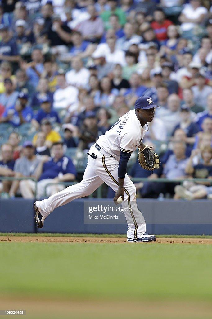 Yuniesky Betancourt of the Milwaukee Brewers makes the flip to first base for an out during the game against the Los Angeles Dodgers at Miller Park...