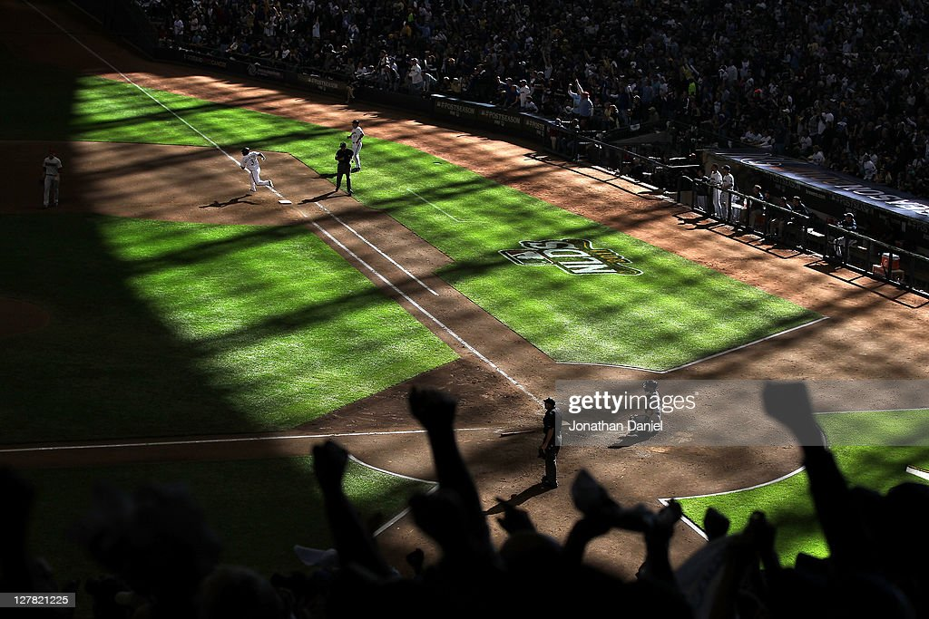 Yuniesky Betancourt of the Milwaukee Brewers runs the bases after hitting a triple in the sixth inning against the Arizona Diamondbacks during Game...