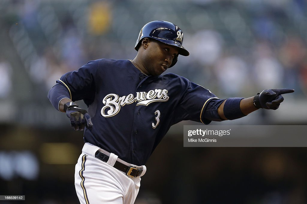 Yuniesky Betancourt of the Milwaukee Brewers runs the bases after hitting a two run homer scoring Carlos Gomez in the bottom of the first inning...
