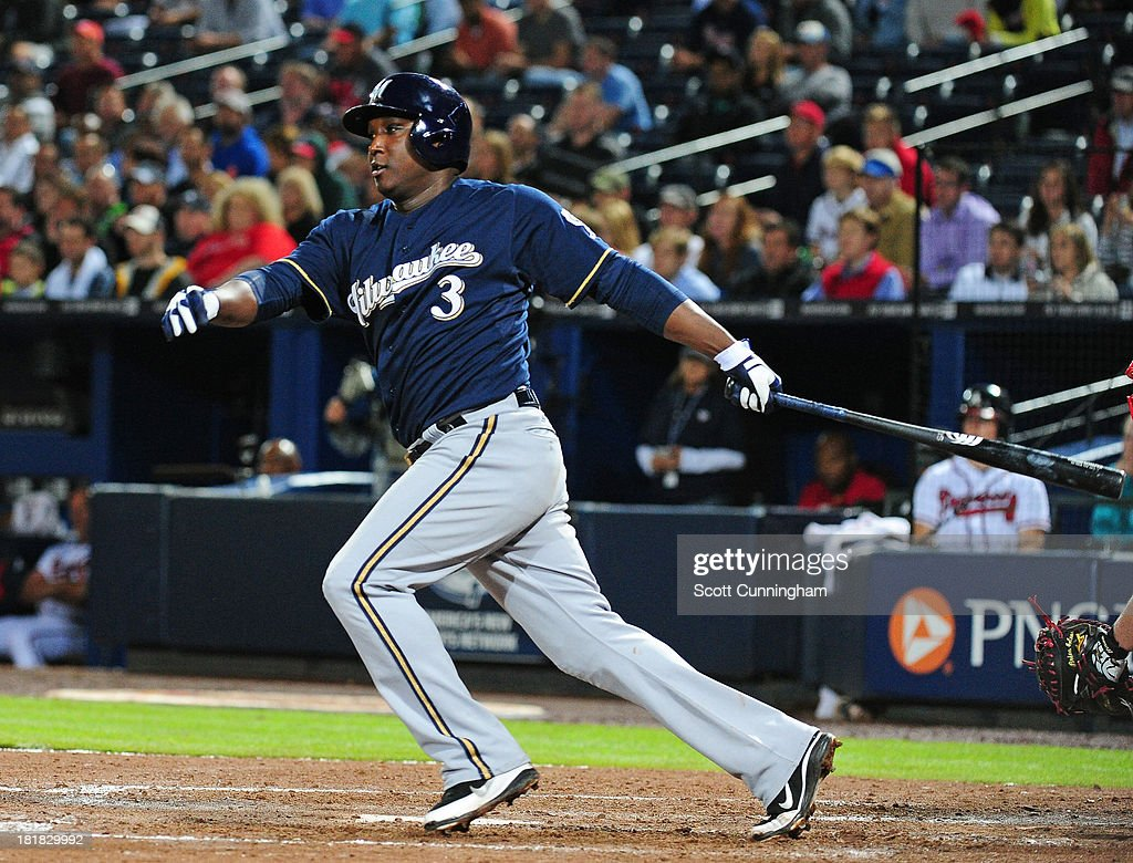 Yuniesky Betancourt of the Milwaukee Brewers singles against the Atlanta Braves at Turner Field on September 25 2013 in Atlanta Georgia
